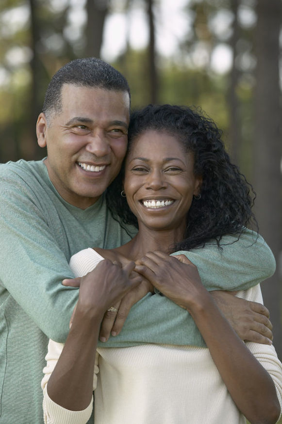 African American couple in an embrace smiling