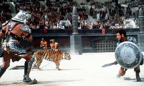 Roman in ring fighting a tiger with sword for entertainment