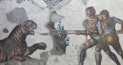 A mosaic of two warriors fending off a tiger with spears