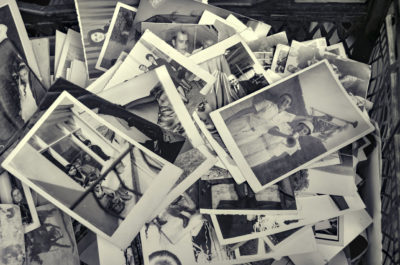 A box of black and white family photos