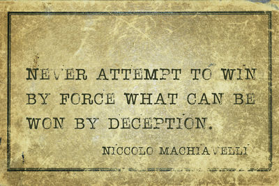 "Text reading ""Never attempt to win by force what can be won by deception"" by Niccolo Machiavelli"